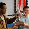 Blen and David holding trophy